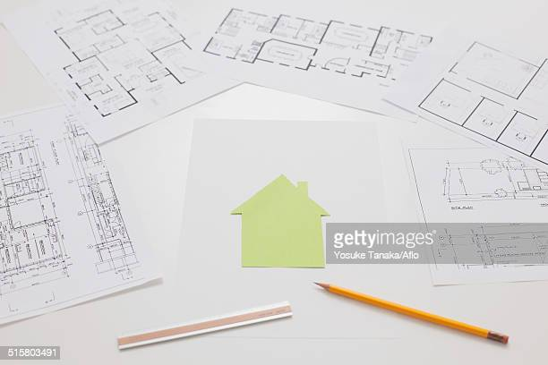 House construction drawings on white table
