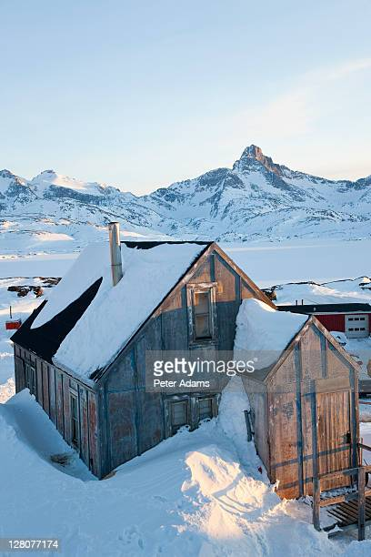 house covered in snow, tasiilaq, greenland in winter - peter adams stock pictures, royalty-free photos & images