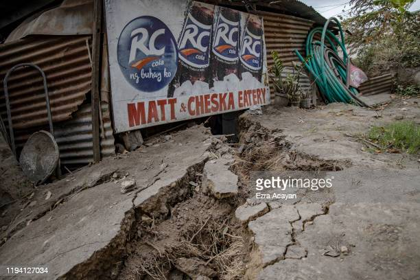 A house damaged by a fissure caused by Taal Volcano's eruption is seen on January 17 2020 in Lemery Batangas province Philippines The Philippine...
