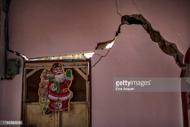 A house damaged by a fissure caused by Taal Volcano's eruption is seen on January 18 2020 in Talisay Batangas province Philippines The Philippine...