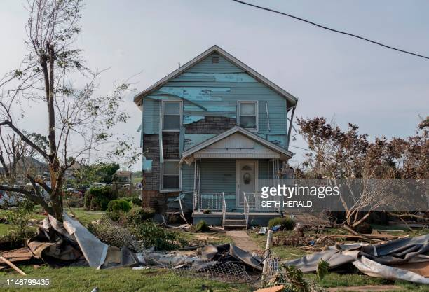 A house damaged by a tornado is seen in Dayton Ohio on May 28 after powerful tornadoes ripped through the US state overnight causing at least one...