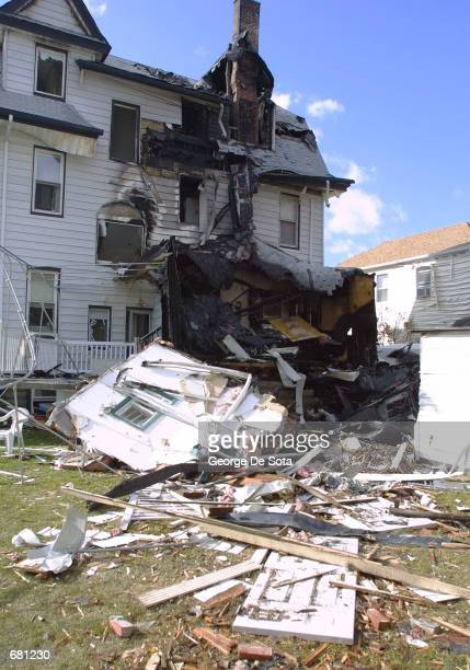 A house damaged by the crash of American Airlines flight 587 stands November 12 2001 in Rockaway Beach New York City The plane carrying 255 people...