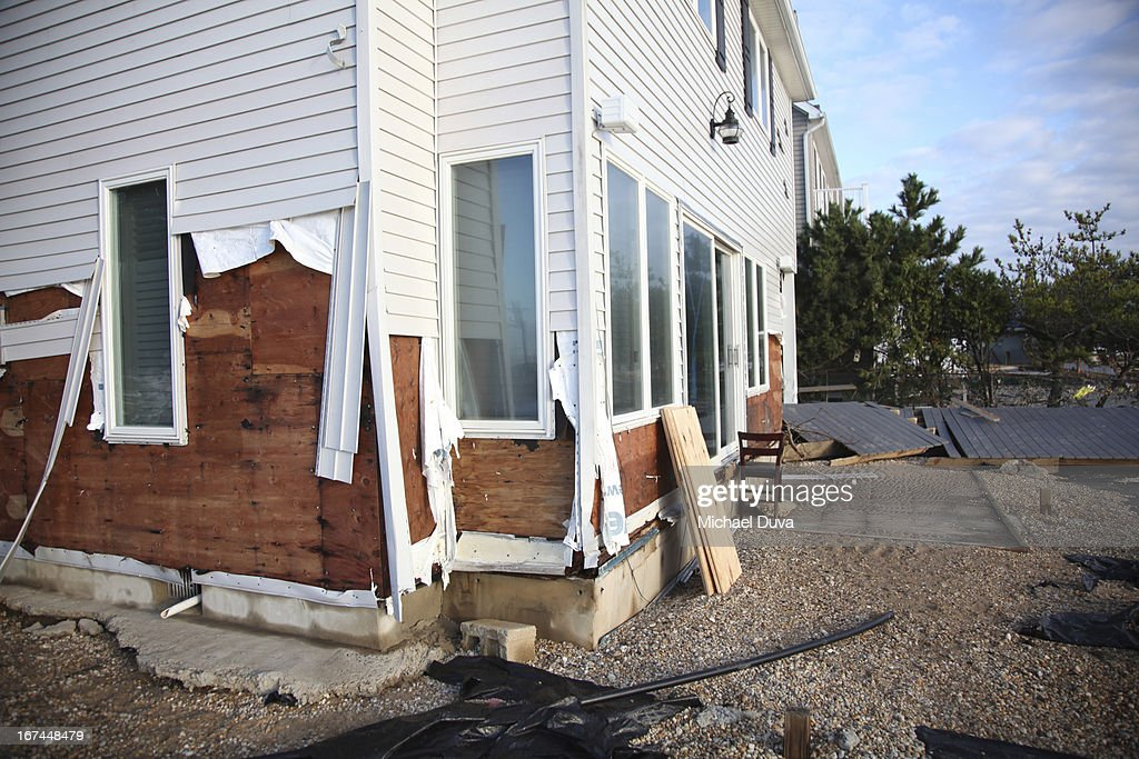 House damaged by winds and water from Sandy storm : Stock Photo