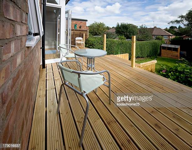 House deck with chairs and a small table