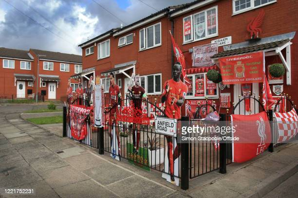 House decorated in Liverpool FC flags, banners and paraphernalia is seen before the Premier League match between Everton FC and Liverpool FC at...