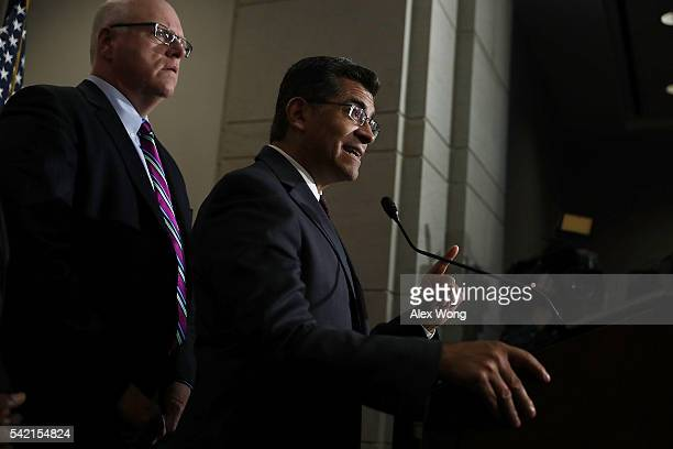 House Democratic Caucus Chair Rep Xavier Becerra speaks to members of the media as House Democratic Caucus Vice Chair Rep Joseph Crowley listens...