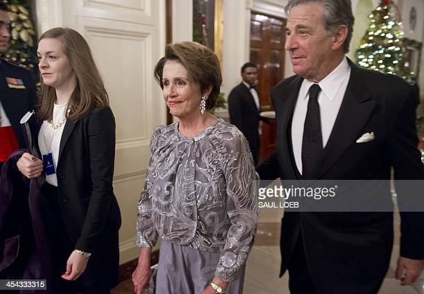 US House Democratic Leader Nancy Pelosi and her husband Paul arrive for a reception for Kennedy Center honorees hosted by US President Barack Obama...