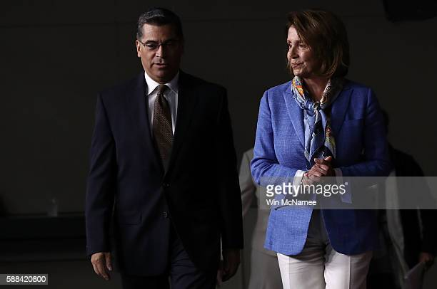 House Democratic Leader Nancy Pelosi arrives with Rep Xavier Becerra for a press conference at the US Capitol August 11 2016 in Washington DC Pelosi...