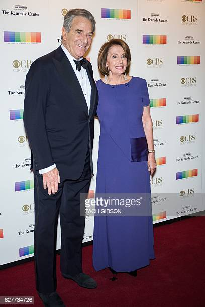 House Democratic Leader Nancy Pelosi poses on the red carpet with her husband Paul Pelosi before the 39th Annual Kennedy Center Honors December 4...