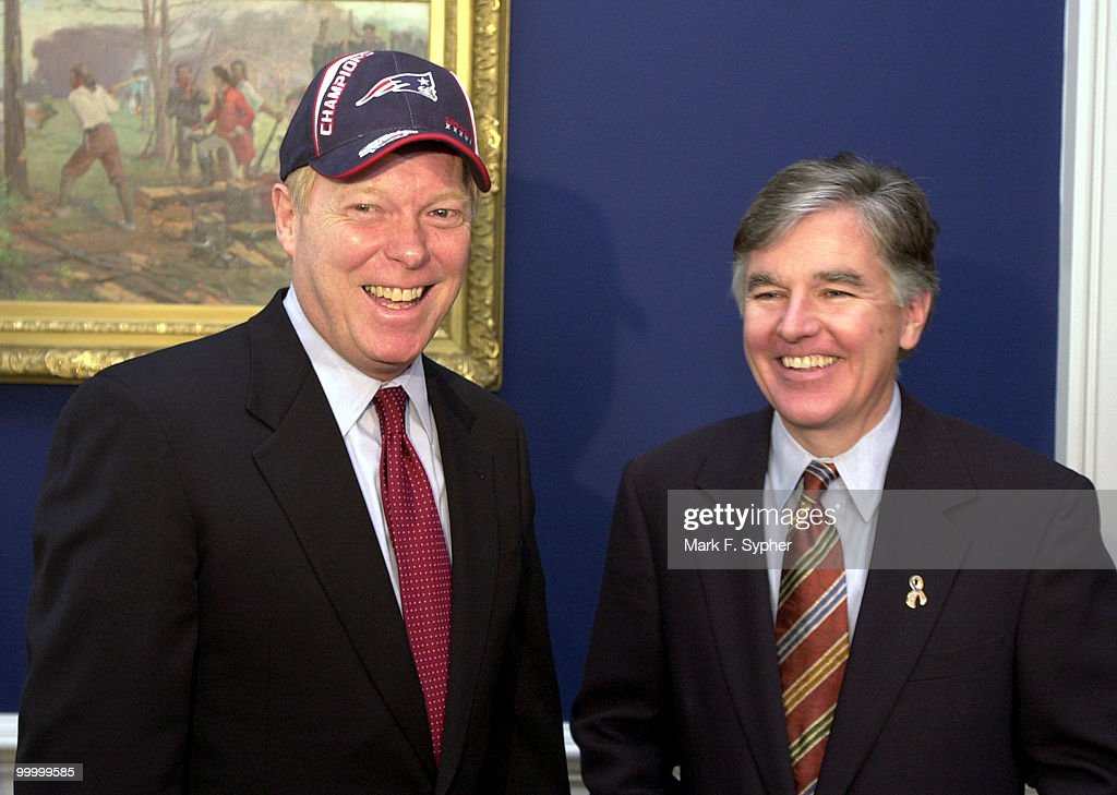 House Democratic Leader Richard A. Gephardt (D-MO) dons the cap of the Super Bowl Champion New England Patriots, loaned to him by Rep. Martin T. Meehan (D-MA) when the two got together to settle their Super Bowl bet, which included toasted ravioli, soft-pretzels and a case of Budweiser.