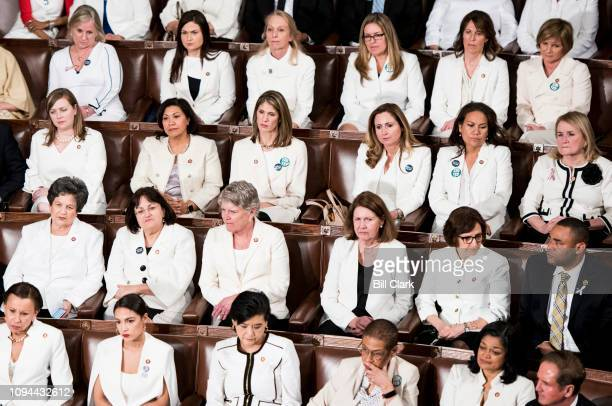 House Democratic women wear white during President Donald Trump's State of the Union Address to a joint session of Congress in the Capitol on Tuesday...