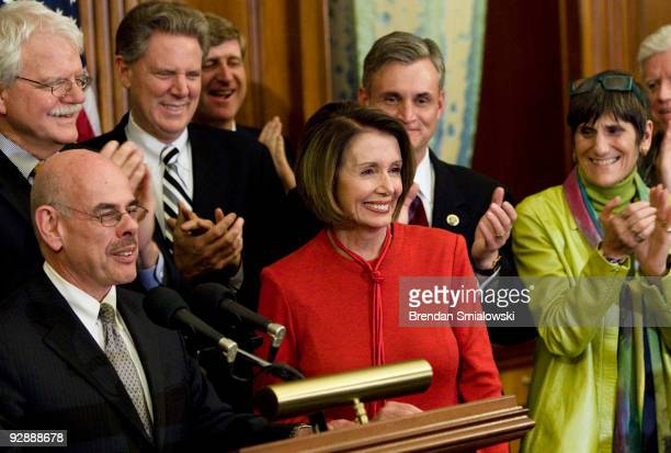 House Democrats clap for Speaker of the House Nancy Pelosi during a press conference after a vote on healthcare on Capitol Hill November 7 2009 in...