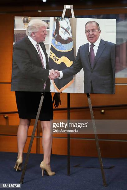 House Democrats display a photograph of President Donald Trump welcoming Russian Foreign Minister Sergey Lavrov to the White House during a news...
