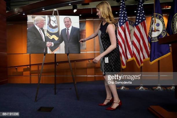 House Democrats display a photograph of President Donald Trump welcoming Russian Foreign Minister Sergey Lavrov to the White House before a news...