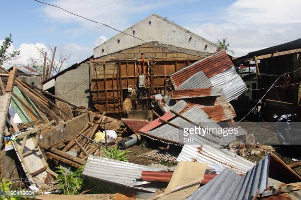 A house destroyed at the height of Typhoon Phanfone is seen in Balasan town in Iloilo province on December 26 2019 Typhoon Phanfone swept across...