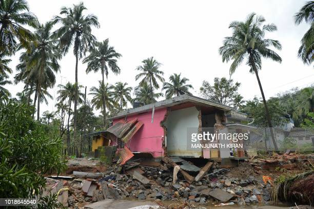 A house destroyed by a landslide is pictured at Kannapanakundu village about 422 km north of Trivandrum in the south Indian state of Kerala on August...
