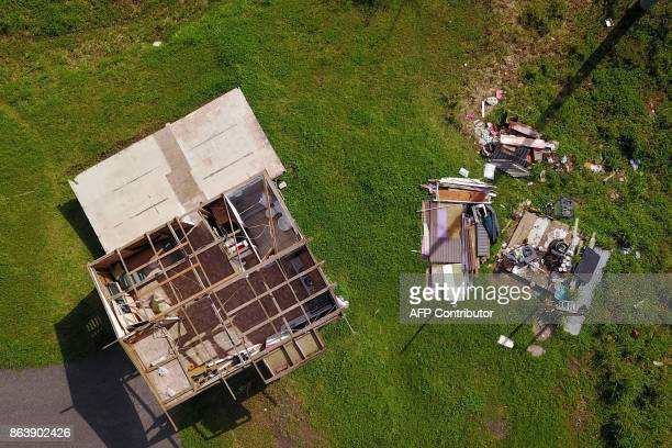 A house destroyed by hurricane winds is seen in Barranquitas southwest of San Juan Puerto Rico on October 20 2017 a month after the passage of...