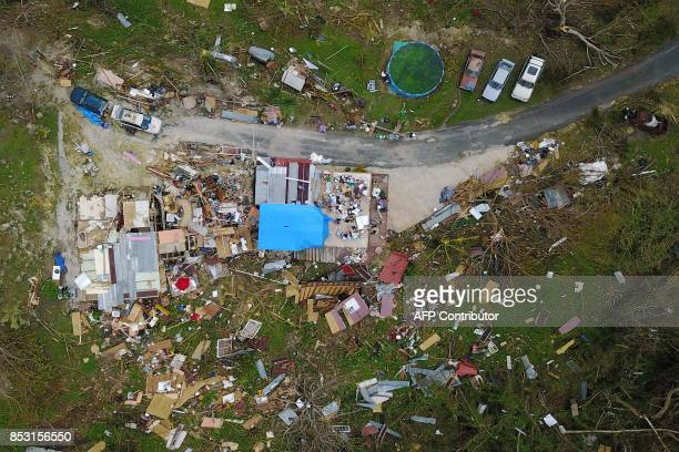 House destroyed by hurricane winds is seen in Corozal, west of San Juan, Puerto Rico, on September 24, 2017 following the passage of Hurricane Maria....