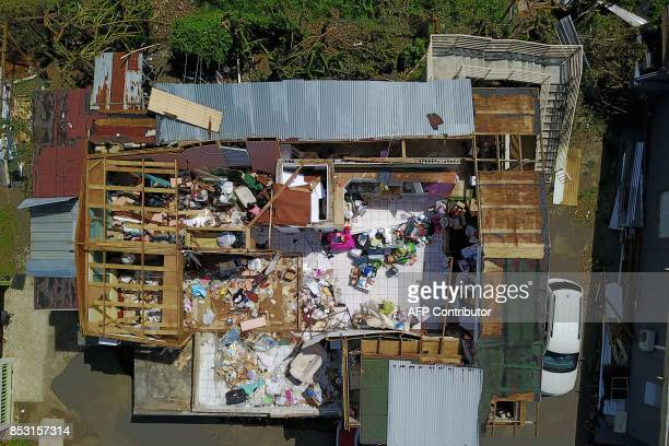 A house destroyed by hurricane winds is seen in Toa Alta southwest of San Juan Puerto Rico on September 24 2017 following the passage of Hurricane...