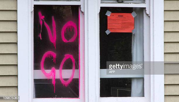 A house displays a 'no go' notice in the earthquakedamaged outer central business district of Christchurch on March 6 2011 It will take at least 10...