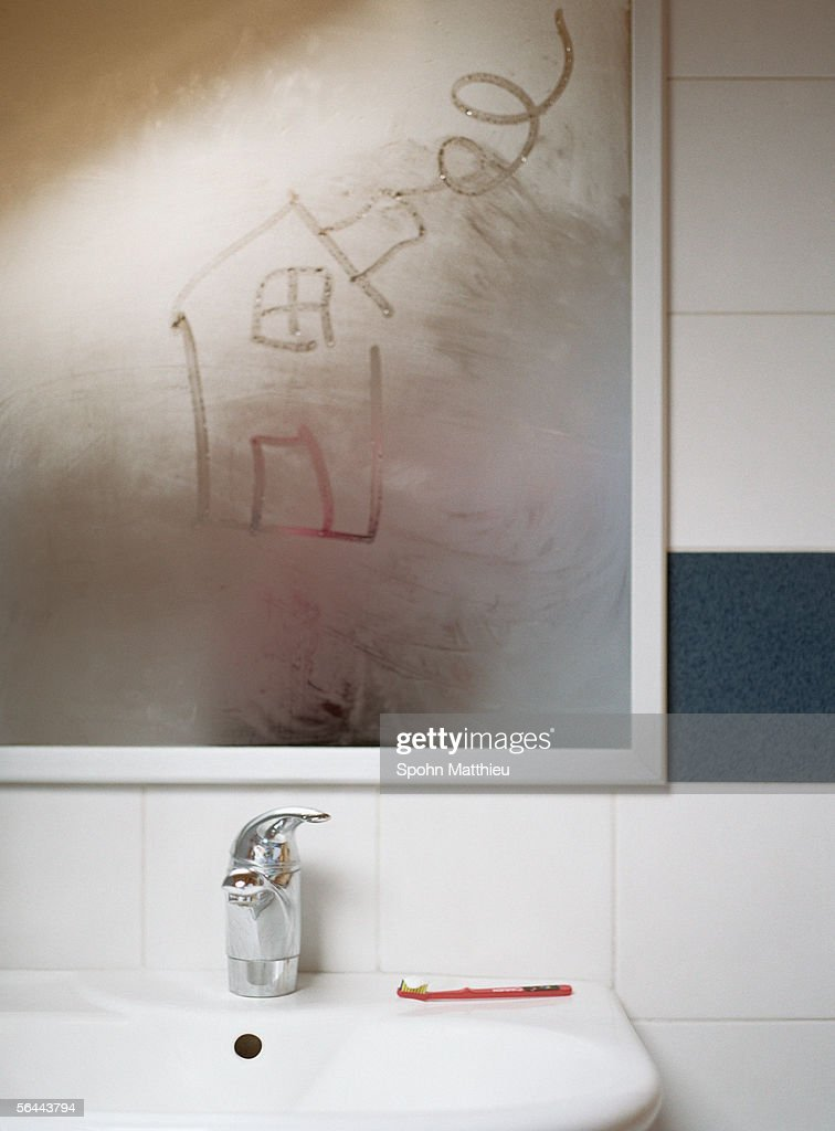 House drawn in condensation on bathroom mirror : Stock Photo