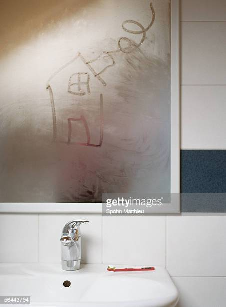 house drawn in condensation on bathroom mirror - mirror steam stock photos and pictures