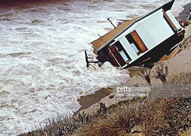house drowning in river - house collapsing stock pictures, royalty-free photos & images