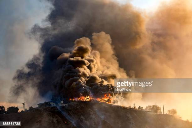 A house engulfed in flames as the Creek Fire burns in Los Angeles California on December 5 2017 The raging fire fueled by strong Santa Ana winds has...