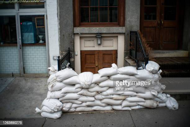 A house entrance is blocked to prevent flooding at the South Street Seaport as the city gets ready for tropical storm Isaias on August 4 2020 in New...