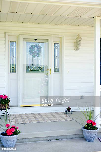 house entrance with white siding and potted plants - dana white stock pictures, royalty-free photos & images