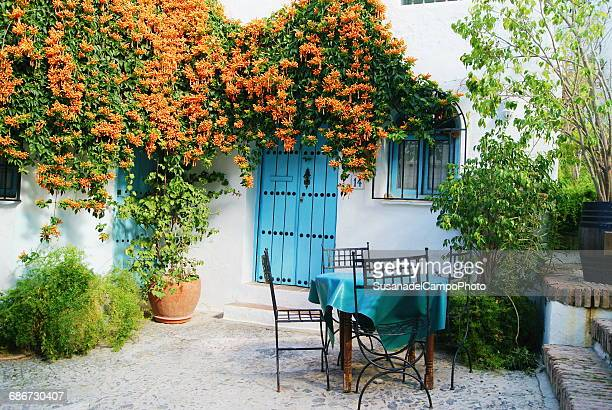 House exterior with patio furniture, Malaga, Andalucia, Spain