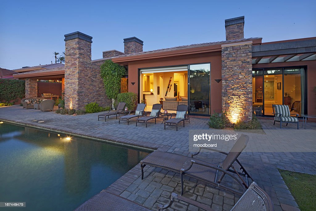 House Exterior with swimming pool : Stock Photo