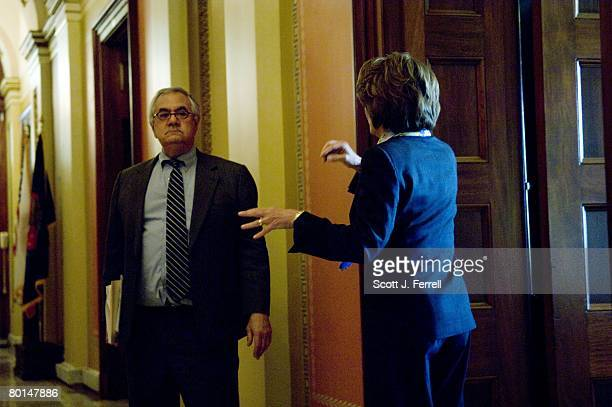 House Financial Services Chairman Barney Frank DMass and House Speaker Nancy Pelosi DCalif talk in the hallway outside Pelosi's office before her...