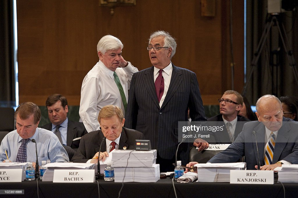 House Financial Services Chairman Barney Frank, D-Mass., standing, consults with Senate Banking Chairman Christopher J. Dodd, D-Conn., during the House-Senate conference on a comprehensive financial regulatory overhaul bill. At left are Ed Royce, R-Calif., and House Financial Services ranking member Spencer Bachus, R-Ala.; at right is Rep. Paul E. Kanjorski, D-Pa.