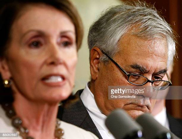 House Financial Services Committee Chairman Barney Frank listens to Speaker of the House Nancy Pelsoi speak to the news media on Capitol Hill...