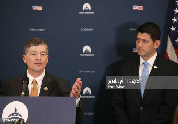 House Financial Services Committee Chairman Jeb Hensarling speaks to the media while flanked by US Speaker of the House Rep Paul Ryan after attending...