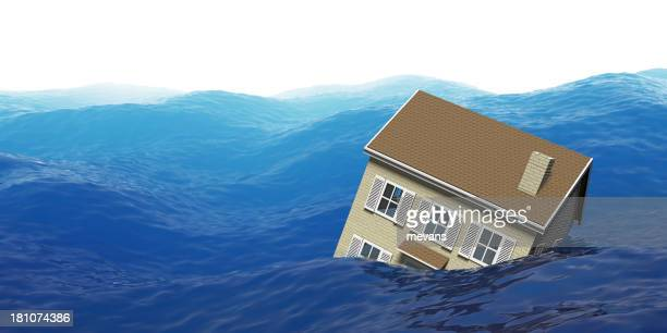 House floating in ocean during a flood