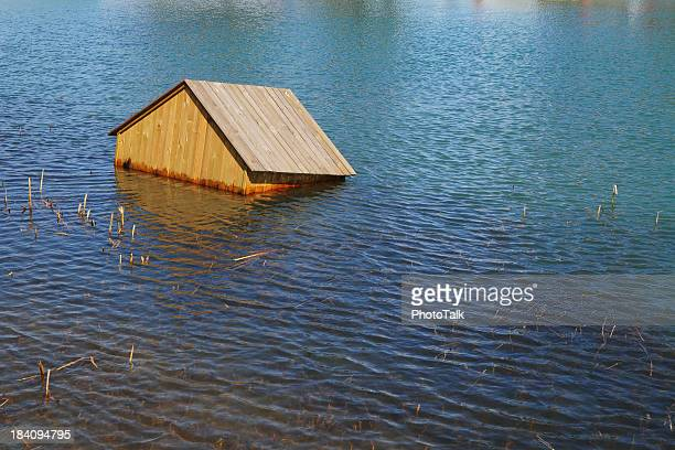 house floating on water - xlarge - house collapsing stock pictures, royalty-free photos & images