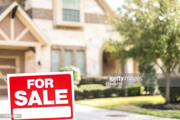 house for sale with real estate sign in yard. - selling stock pictures, royalty-free photos & images