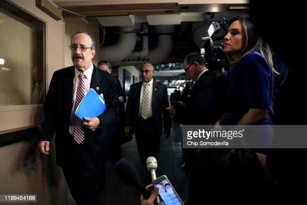 House Foreign Affairs Committee Eliot Engel walks past journalists as he arrives for the weekly House Democratic Caucus meeting in the basement of...