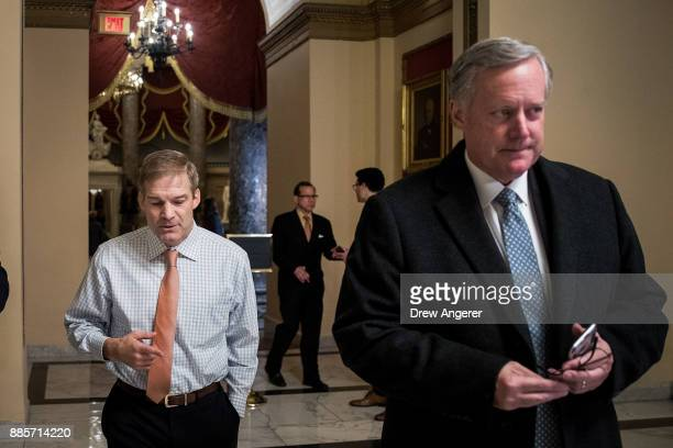 House Freedom Caucus member Rep Jim Jordan walks with House Freedom Caucus chairman Rep Mark Meadows on Capitol Hill December 4 2017 in Washington DC...