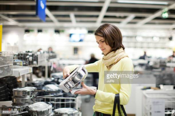 house goods shopping - convenience store interior stock photos and pictures
