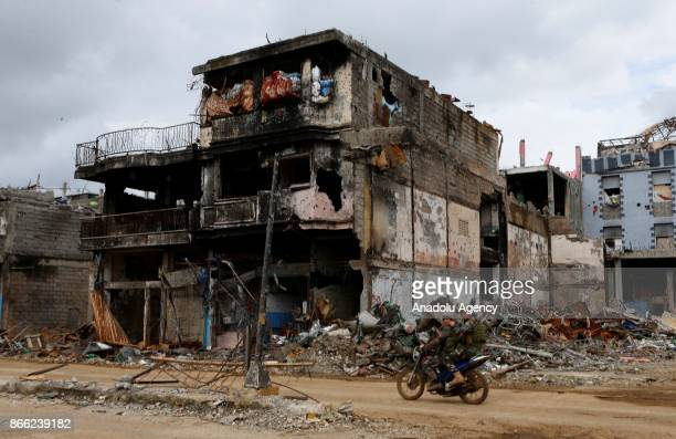 A house heavily damaged in the main battle is seen in Marawi Lanao del Sur in the Southern Philippines on October 25 2017 The military showed to...