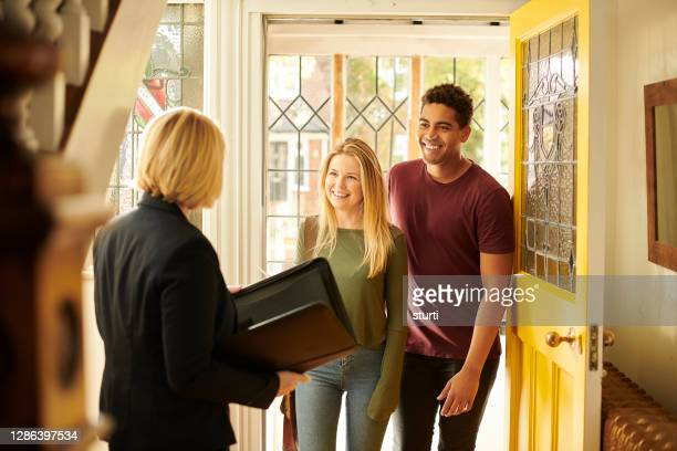 house hunting couple - house stock pictures, royalty-free photos & images