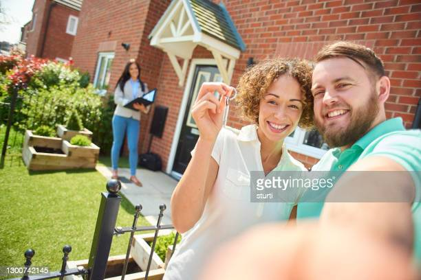 house hunting success - couple relationship stock pictures, royalty-free photos & images