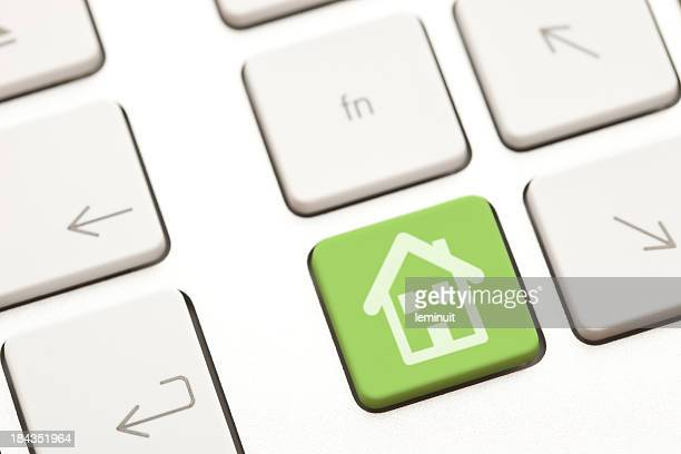 House icon on a green computer key