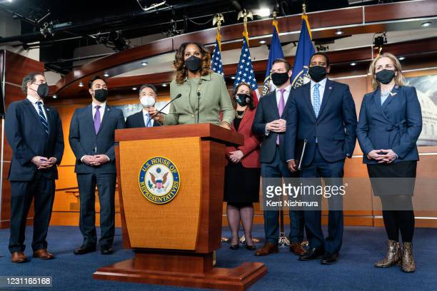 House Impeachment Manager Del. Stacey Plaskett , center, speaks during a press conference at the U.S. Capitol Building on Saturday, Feb. 13, 2021 in...
