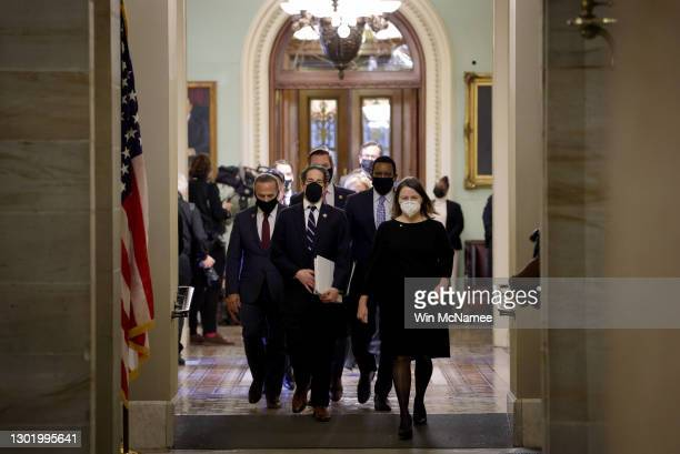 House impeachment managers led by Rep. Jamie Raskin depart the Senate Chamber at the conclusion of former President Donald Trump's second impeachment...