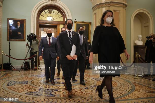 House impeachment managers, led by Rep. Jamie Raskin leave the Senate Chamber after the conclusion of former President Donald Trump's impeachment...