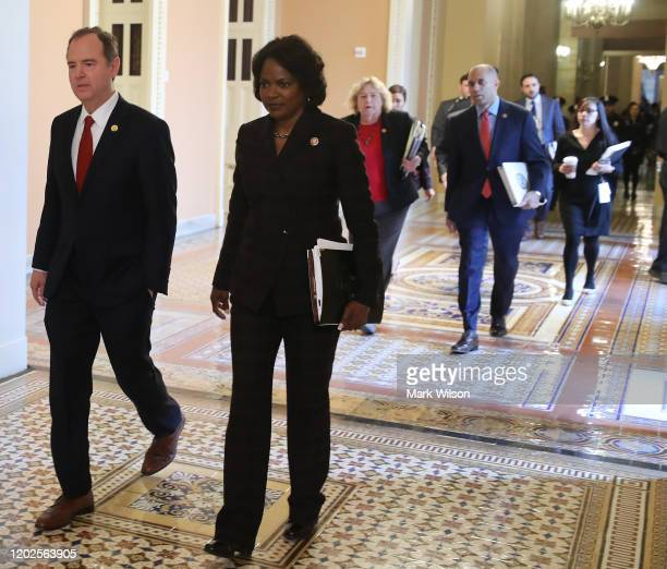 House impeachment managers Rep Adam Schiff Rep Val Demings Rep Zoe Lofgren and Rep Hakeem Jeffries walk to the Senate Chamber inside the US Capitol...